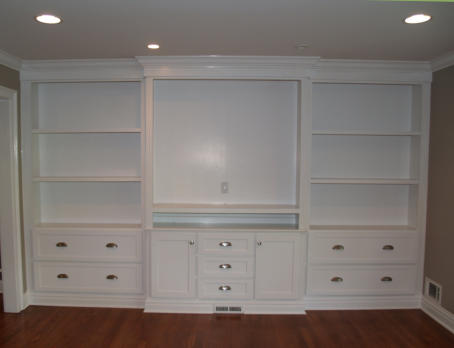 We can help design an incredible entertainment wall unit for you.